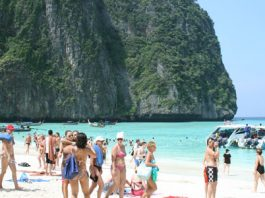 people on a beach in thailand